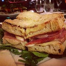 "The ""Vintage"" Monsieur, with black olive ciabatta, ham, emmental and bechamel."