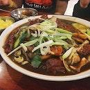 Giant plate of Boneless Jjimdak 🍗: boneless chicken thigh meat in a stew of carrots, potatoes, and sweet potato noodles in a spicy ganjang sauce!