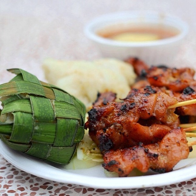 Beautifully seasoned and char-grilled to a moist tenderness, these pork and chicken skewers (satay) are a sinful indulgence.