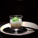 L'Atelier's dessert/ palate cleanser is inspired by the Caipirinha, incorporating cachaca granita, passion banana cream, coconut nectar and lime.