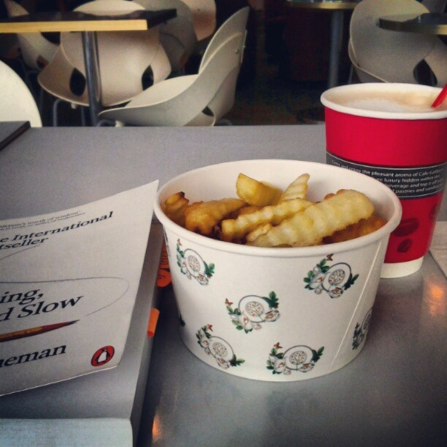 Chicken chunks, fries, latte and a good book for lunch.