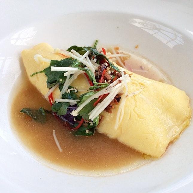 Crab Omelette, enoki mushroom and herb salad, miso mustard broth.