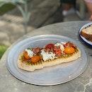 Grilled Tomato Flatbread ($16.60)