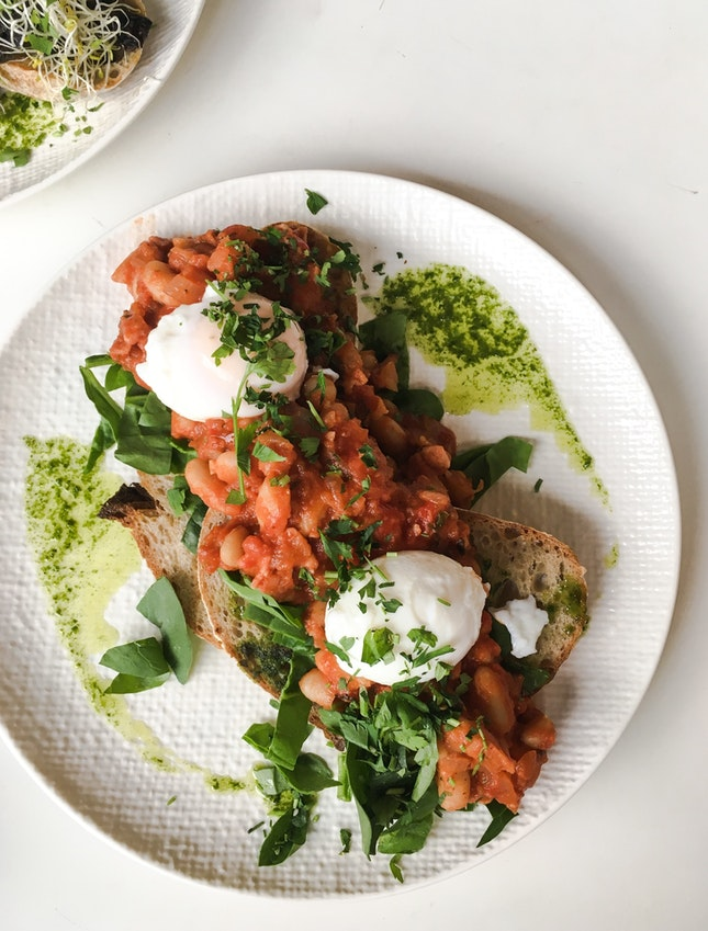 Homemade Bacon Baked Beans on Herb Sourdough with Poached Eggs