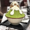 Matcha Star Kakigori —$11.90 Strong matcha flavour with azuki beans and a scoop of icecream hidden inside.