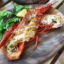 Live lobsters over the seafood counter, pay and grab over to the grill kitchen.