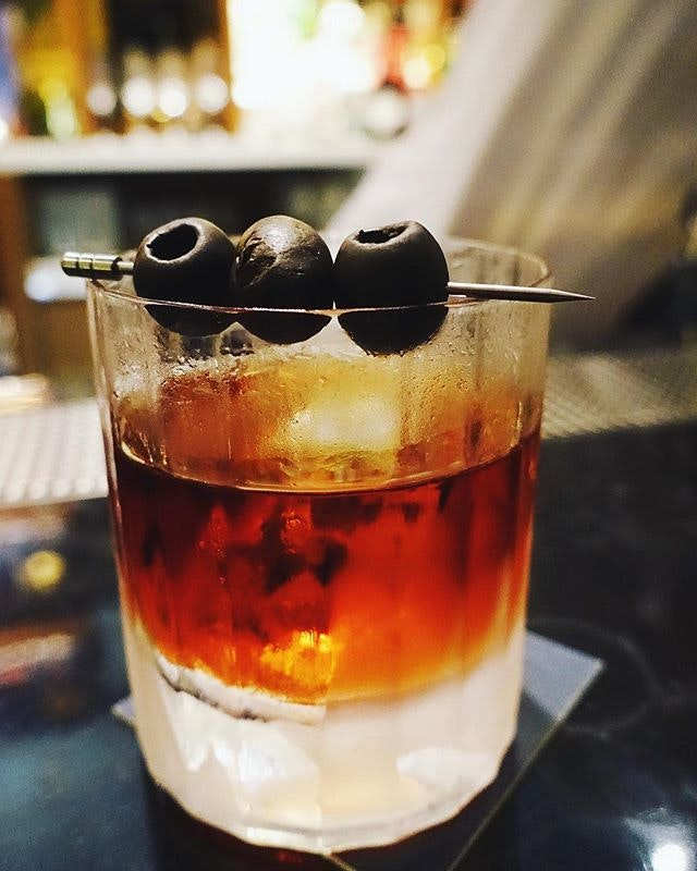 Need one of this Smoked Black Olive Negroni at the newly opened @marcello_sg @intercontinentalrq.
