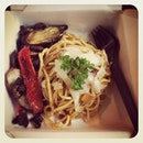 Red pesto spaghetti with grilled eggplants, capsicum, and mushrooms.