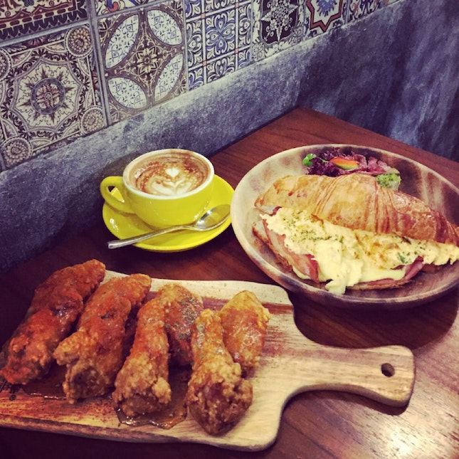 honey paprika wings, butter crossiant, flat white