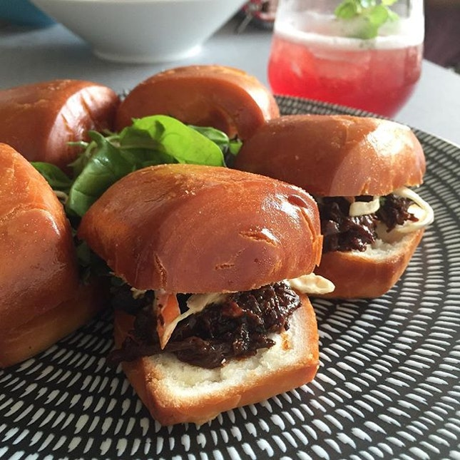 """Check out the #nofilter beauty of the signature beef brisket in """"mantou"""" buns we had sometime ago."""