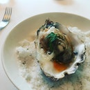 pensive Normandy oyster with a thin blanket of lard and crown of oscietra caviar.