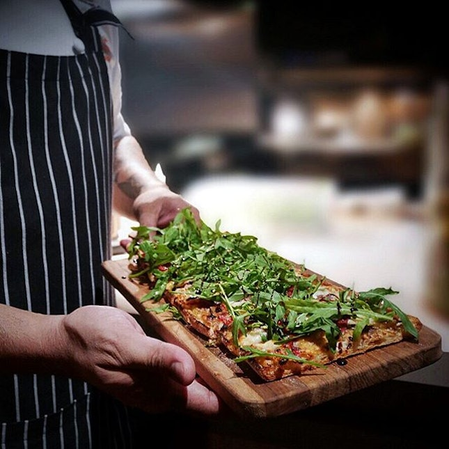 Coca de Cebolla y Pimientos •SGD 16•  A pizza-style dish using imported coca (Catalan Flatbread) that features a thin and crispy base with a savoury topping of caramelized onions, roasted peppers, anchovies, manchego (Spanish cheese) and a good lashing of homemade reduced balsamic over it.