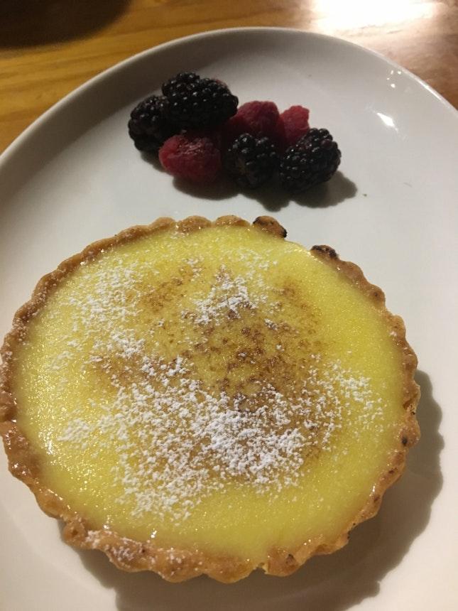 Lemon tart with fresh berries.