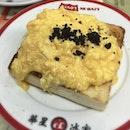 Black truffle scrambled eggs on toast.