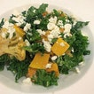 Roasted cauliflowers with kale and pumpkins sprinkled with feta.