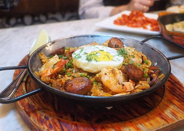 Spanish fried rice aka paella with loads of ingredients: chorizo, chicken, prawns, squid and sunny side up.