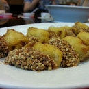 Fancy duet of nian gao (sweet cake) deep fried n coated with peanuts