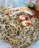 The votes are divided as to where fries the best fried hokkien mee in Singapore.