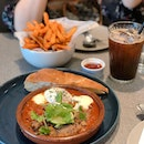Brunch w momma- we got the Tuscan lamb harissa baked eggs and a side of sweet pederder friez.