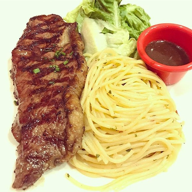Steak & Pasta Combi [$9.90 - student lunch promo] The aglio olio was great but the ribeye steak was a bit too hard for the medium well request.