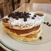 Pancake stack with chocolate chunks and maple butter