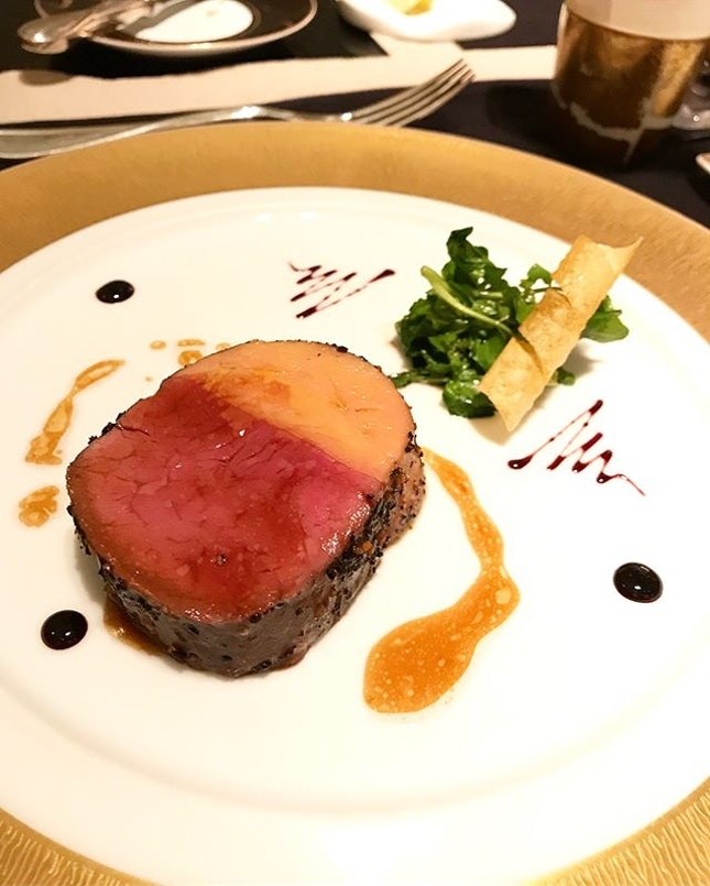 """Le Boeuf :: Beef Châteaubriand and foie gras , """"Rossini"""" style with potato soufflés and Port wine reduction @joel_robuchon_singapore #corainsingapore swipe for more pics 📲 ."""