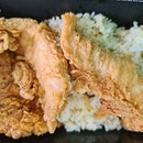 2 pcs chicken tenders + 1 pc fish + garlic rice + drink ($9.50)!