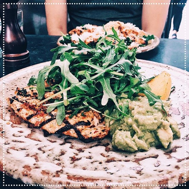 """[Common Man Coffee Roasters] Juicy grilled """"chili"""" boneless chicken with crushed avocado salsa and caremelised lemon, S$25."""
