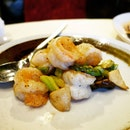 Wok tossed shrimps with black truffle and vegetables.