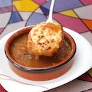 -Fumee Onion Soup Gratinee- It takes around 4hours slow-cook to create this rich umami taste from the caramelized onions with red wine, beef stock and herbs.