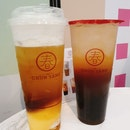 Honey Lemon Oolong Tea With Pearls ($6.90 + $0.80) And Cheese Macchiato With Tea And Pudding ($6.50 + $1.20)