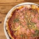 [Tanjong Katong] I don't usually have nuts on my pizza, but the Bologna ($22.90) sees chopped pistachios scattered over—and it makes perfect sense since they're found in mortadella, which is also strewn over the pizza.