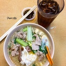 Pork noodle soup with pork lard, complimenting with egg and fresh chilies in soy sauce.