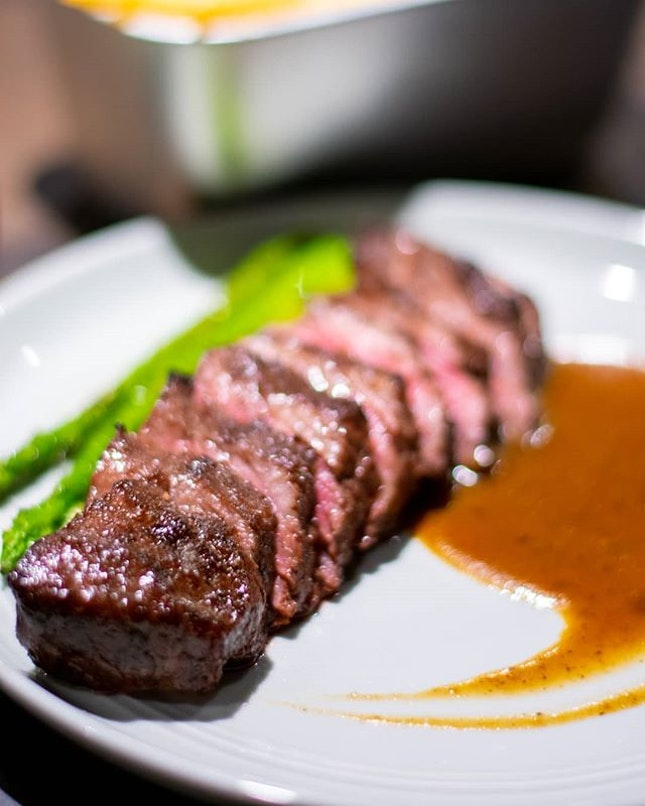 - Invited Tasting -  Char grilled steak served contemporary style.