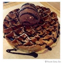 Rocky road ice cream on buttermilk waffle with dark chocolate sauce