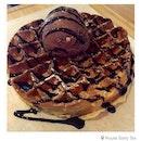Rocky road ice cream on buttermilk waffle with dark chocolate sauce