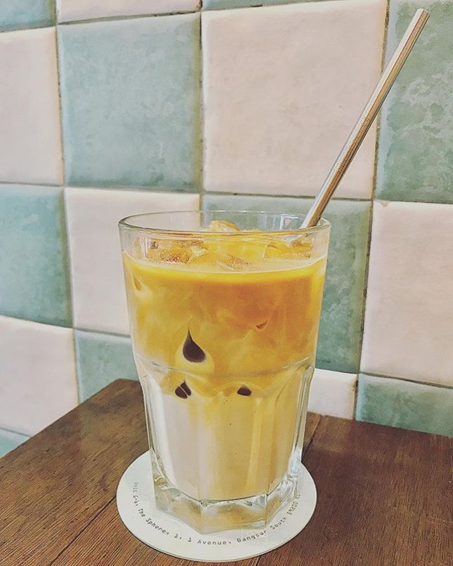 An iced latte complete with eco-friendly metal straw!