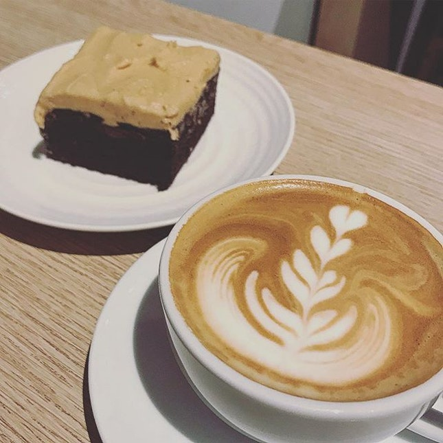 A cappuccino (skinny, why waste calories!) and a slab of peanut butter and chocolate brownie!!