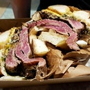 A Gorgeous Steak & Egg Bagel Sandwich ($14).