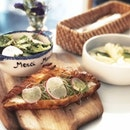 Marinated crab tartine with avocado and croissant.