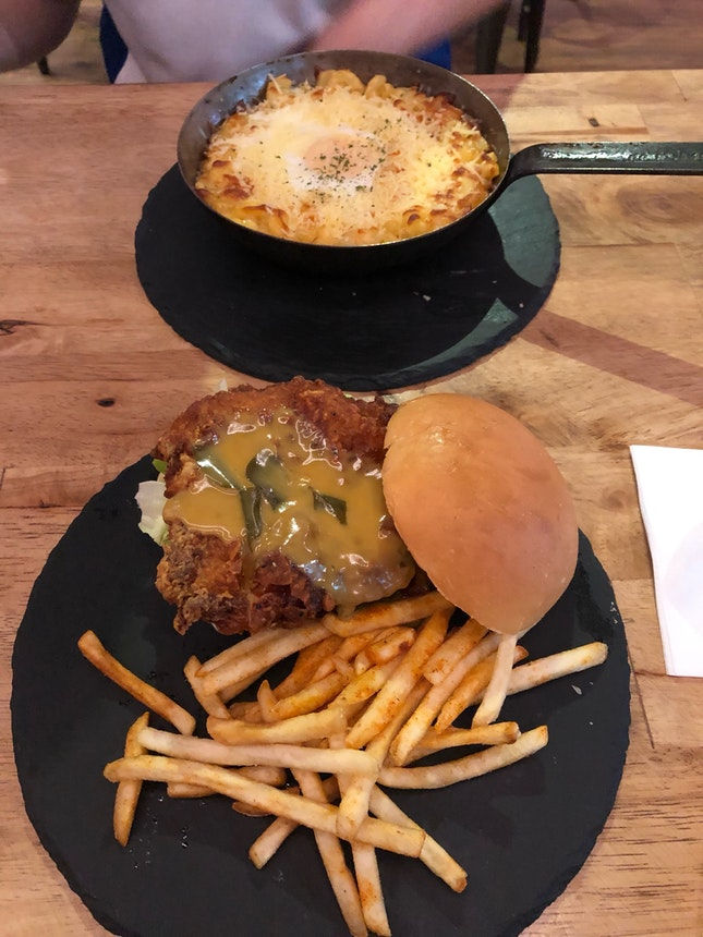 Salted egg chicken burger $17.9++, Mac and cheese $15.9++
