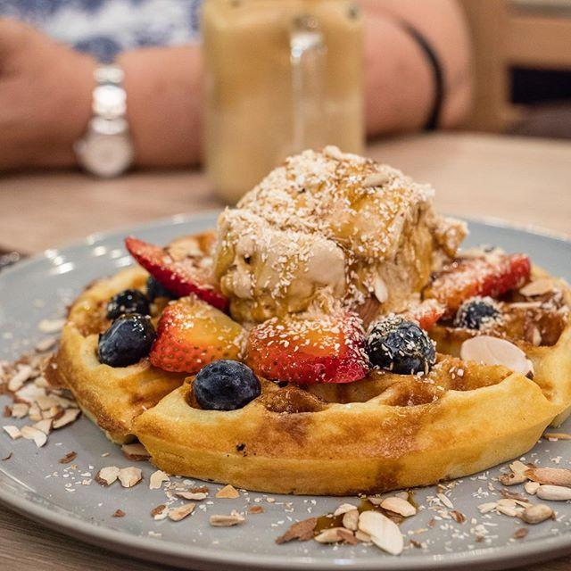 Salted Gula Melaka Waffle | buttermilk waffle, seasalt caramel ice cream, salted gula melaka drizzle, roasted nuts, berries