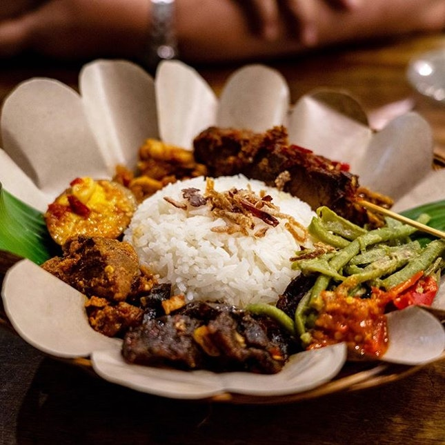 Nasi Campur Bali | Balinese style beef rendang, sambal shredded chicken, sliced beef tossed with sambal, egg tossed with Balado sambal, sweet and spicy tempeh, stir-fried long beans and beef skewers with basted home sambal