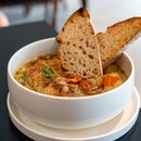 Summer Chicken Stew   slow-roasted chicken thigh, roasted potatoes & carrots, sundried tomato cream broth, toasted sourdough