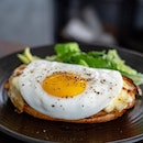 Croque Madame | classic French ham and cheese sandwich covered in cheesy béchamel sauce topped with a sunny side up fried egg