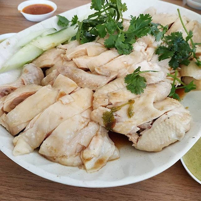 """Saw the banner at the chicken rice stall: """"whole chicken at $9.90""""."""