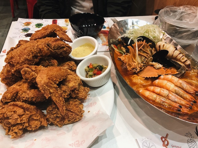 Spicy seafood soup ($26.90) and crispy fried chicken ($26.90)