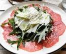 Angus Beef Carpaccio w Parmigiano Shavings 👍🏻👍🏻👍🏻👍🏻 $16++ .