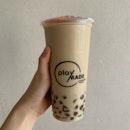 Tieguanyin Milk Tea with Burnt Caramel Pearls
