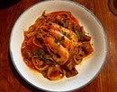 Sage & Onion Fettuccine with Sautéed Prawns and White Button Mushrooms in a Roasted Red Pepper Sauce ($14.90)